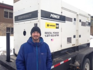 Ron Mentch, Assistant Operations Superintendent with temporary 250 Kilowatt generator.